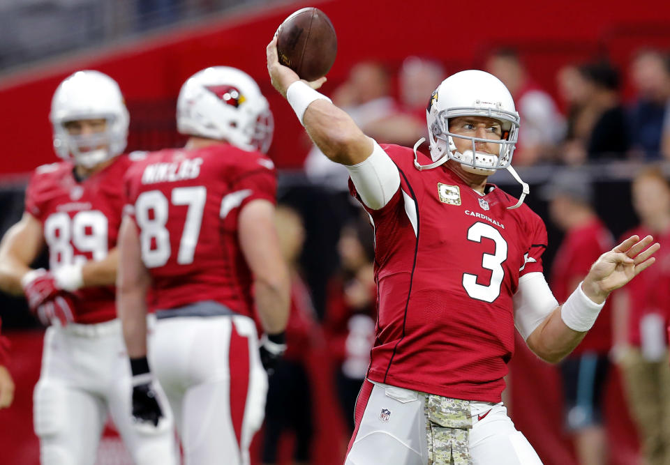 Arizona Cardinals quarterback Carson Palmer (3) warms up before an NFL football game against the St. Louis Rams, Sunday, Nov. 9, 2014, in Glendale, Ariz. (AP Photo/Rick Scuteri)