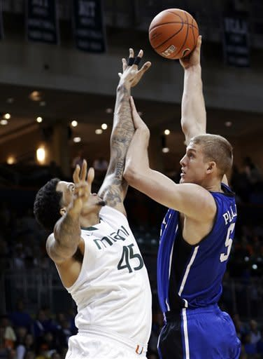 Duke's Mason Plumlee (5) shoots over Miami's Julian Gamble (45) during the first half of an NCAA college basketball game in Coral Gables, Fla., Wednesday, Jan. 23, 2013. (AP Photo/Alan Diaz)