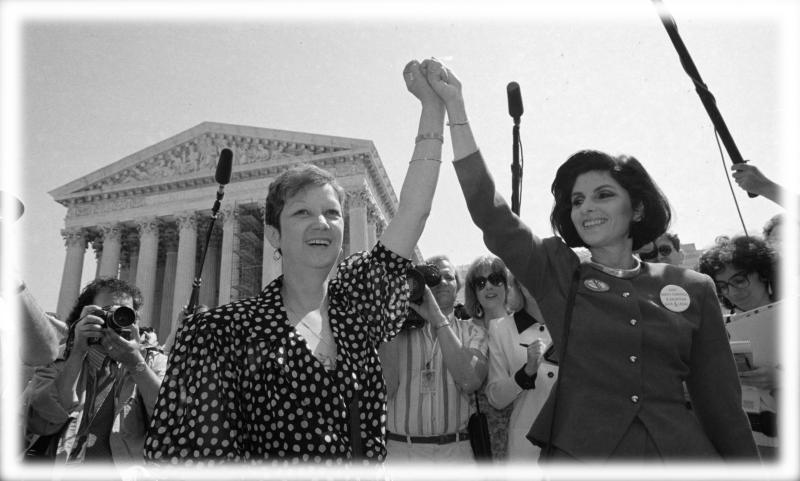 Norma McCorvey, Jane Roe in the 1973 court case, left, and her attorney Gloria Allred hold hands as they leave the Supreme Court building in Washington after sitting in while the court listened to arguments in a Missouri abortion case in April 1989. (Photo: J. Scott Applewhite/AP; digitally enhanced by Yahoo News)