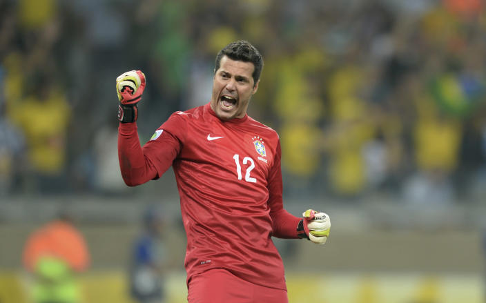 FILE - In this June 26, 2013 file photo, Brazil's Julio Cesar celebrates his team's 2-1 victory at a Confederations Cup semifinal soccer match with Uruguay in Belo Horizonte, Brazil. Cesar is the weakest link in the national team which all of Brazil expects to win the 2014 World Cup. That is no accident: Brazil has long paid far more attention to players who score and make goals than to those who save them. (AP Photo/Eugenio Savio, File)