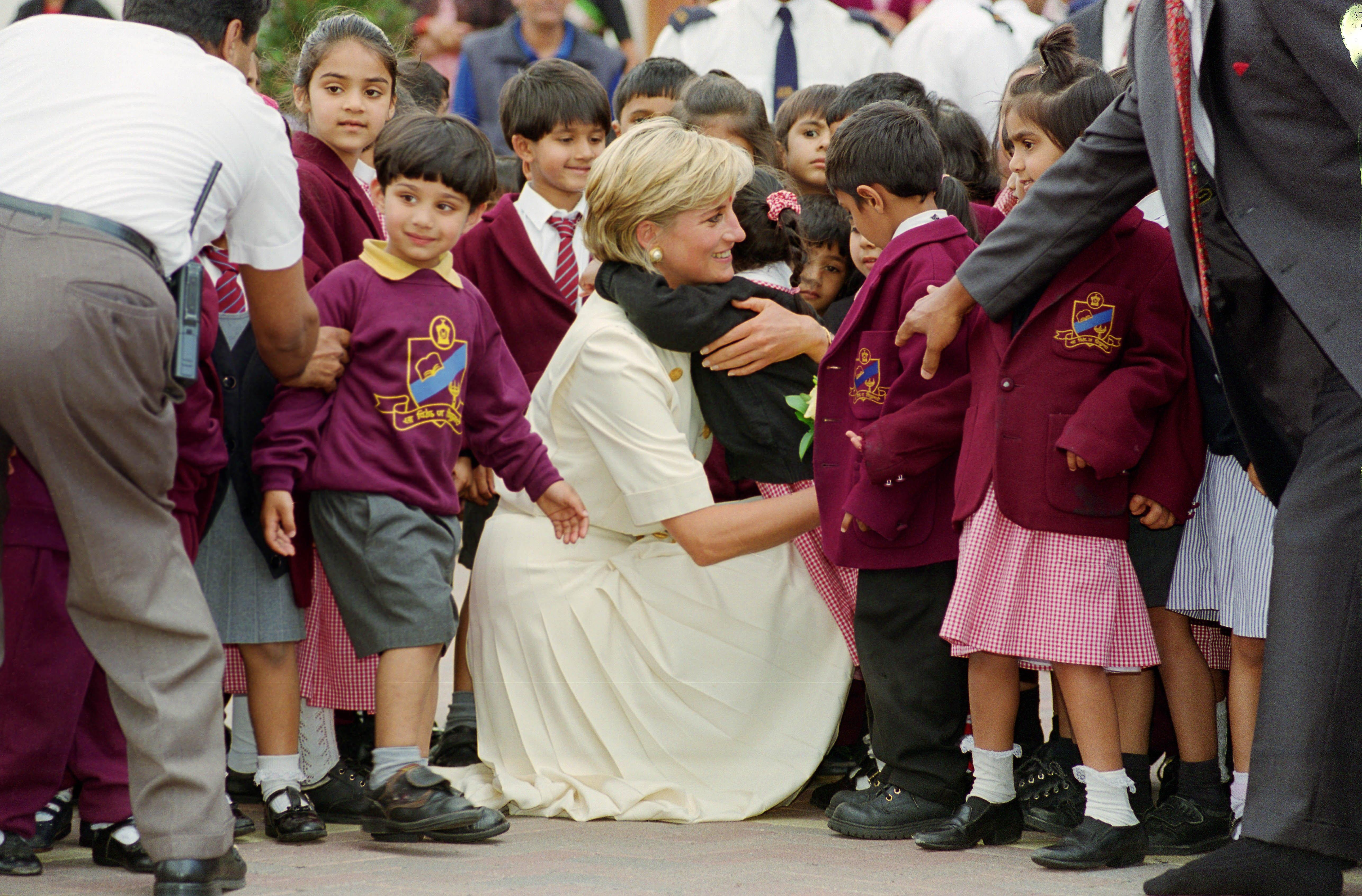 Princess Diana embraces a school pupil in Neasden in 1997 (Photo by Tim Graham/Getty Images)