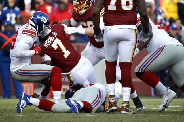 Ouch: Washington QB Dwayne Haskins suffered an ankle injury on this third-quarter play Sunday. (AP/Patrick Semansky)