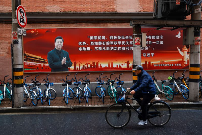 Pictures of Chinese President Xi Jinping overlook a street ahead of the National People's Congress (NPC), in Shanghai