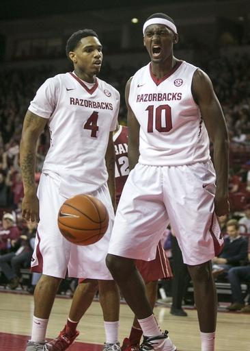 Arkansas forward Bobby Portis (10) and guard Coty Clarke (4) celebrate after an alley-oop dunk during the first half of an NCAA college basketball game against Alabama, Wednesday, Feb. 5, 2014, in Fayetteville, Ark. (AP Photo/Gareth Patterson)