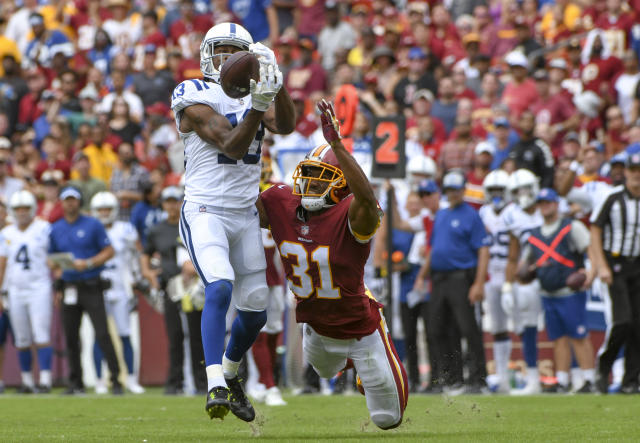 <p>Washington Redskins cornerback Fabian Moreau (31) is called for pass interference on a pass intended for Indianapolis Colts wide receiver T.Y. Hilton (13) in the second quarter on September 16, 2018, at FedEx Field in Landover, MD. : (Photo by Mark Goldman/Icon Sportswire) </p>