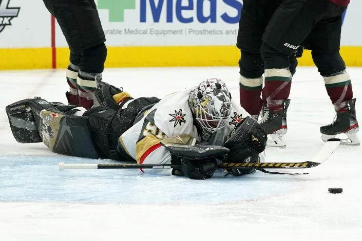 Vegas Golden Knights goaltender Robin Lehner pauses on the ice after giving up a goal to Arizona Coyotes' Michael Bunting during the third period of an NHL hockey game Friday, April 30, 2021, in Glendale, Ariz. The Coyotes won 3-0. (AP Photo/Ross D. Franklin)