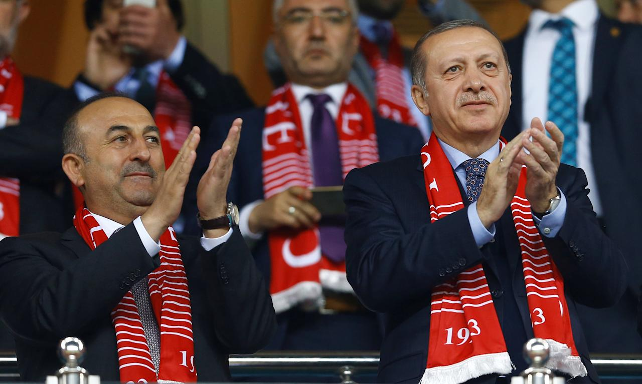 FILE PHOTO: Football Soccer - Turkey v Finland - 2018 World Cup Qualifying European Zone - Antalya arena, Antalya, Turkey - 24/3/17 Turkey's President Tayyip Erdogan and Foreign Minister Mevlut Cavusoglu react after Turkey's win. REUTERS/Murad Sezer/File Photo