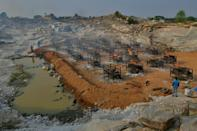Burning pyres of the victims who died of Covid-19 coronavirus have sprung up across India