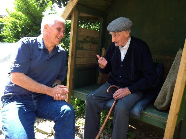 Mike Pence talks to his grandmother's first cousin, 92-year-old Patrick Moloney, during a 2013 trip to Ireland.