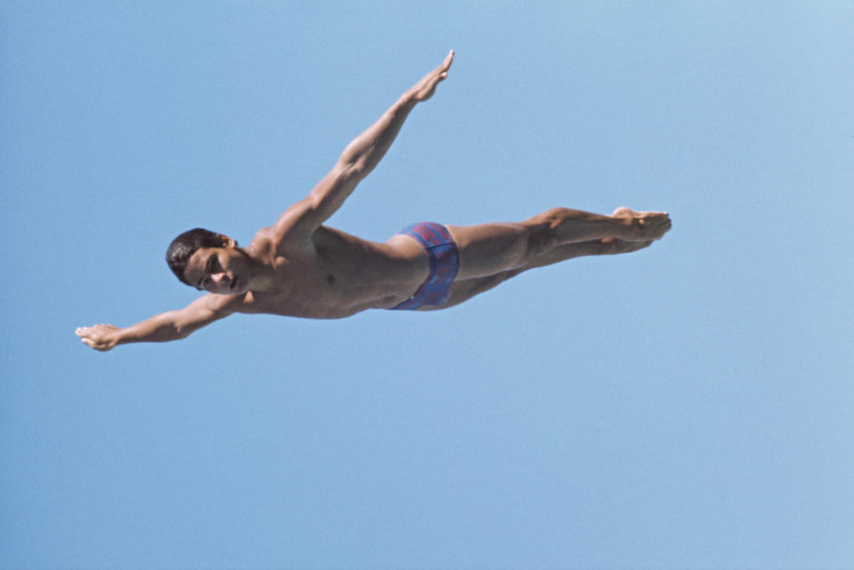 Olympic diver Greg Louganis of the United States performs a practice dive on 1st December 1984 in Los Angeles, California, United States. (Photo by Tony Duffy/Getty Images)