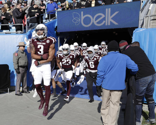 "Texas A&M's <a class=""link rapid-noclick-resp"" href=""/ncaaf/players/251078/"" data-ylk=""slk:Christian Kirk"">Christian Kirk</a> (3) leads the team onto the field before the Belk Bowl NCAA college football game against Wake Forest in Charlotte, N.C., Friday, Dec. 29, 2017. (AP Photo/Chuck Burton)"