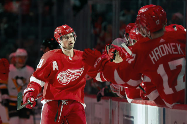 Detroit Red Wings center Dylan Larkin celebrates his goal against the Pittsburgh Penguins in the third period of an NHL hockey game Saturday, Dec. 7, 2019, in Detroit. (AP Photo/Paul Sancya)