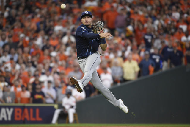 Tampa Bay Rays shortstop Willy Adames (1) throws to first to make the out on Houston Astros designated hitter Yordan Alvarez during the first inning of Game 5 of a baseball American League Division Series in Houston, Thursday, Oct. 10, 2019. (AP Photo/Eric Christian Smith)