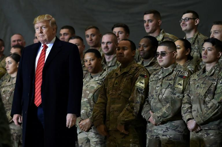 US President Donald Trump speaks to the troops during a surprise Thanksgiving day visit to Bagram Air Field