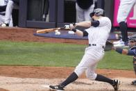 New York Yankees' DJ LeMahieu hits an RBI single during the second inning of a baseball game against the Tampa Bay Rays, Saturday, April 17, 2021, in New York.(AP Photo/Frank Franklin II)