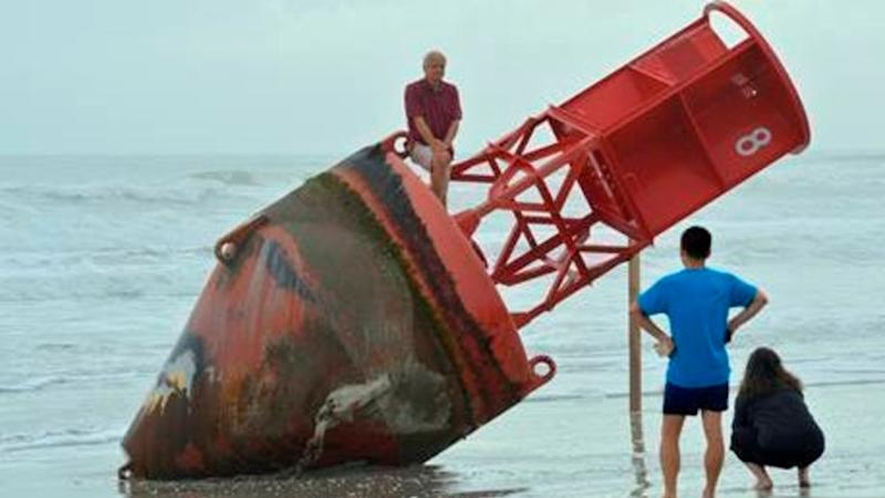 Large buoy removed from Florida beach