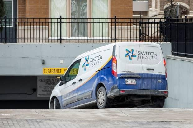 A mobile rapid testing unit van from Switch Health enters the underground parking of a condominium building where Peel Region public health workers tested residents, after five cases of the South African coronavirus variant were confirmed.