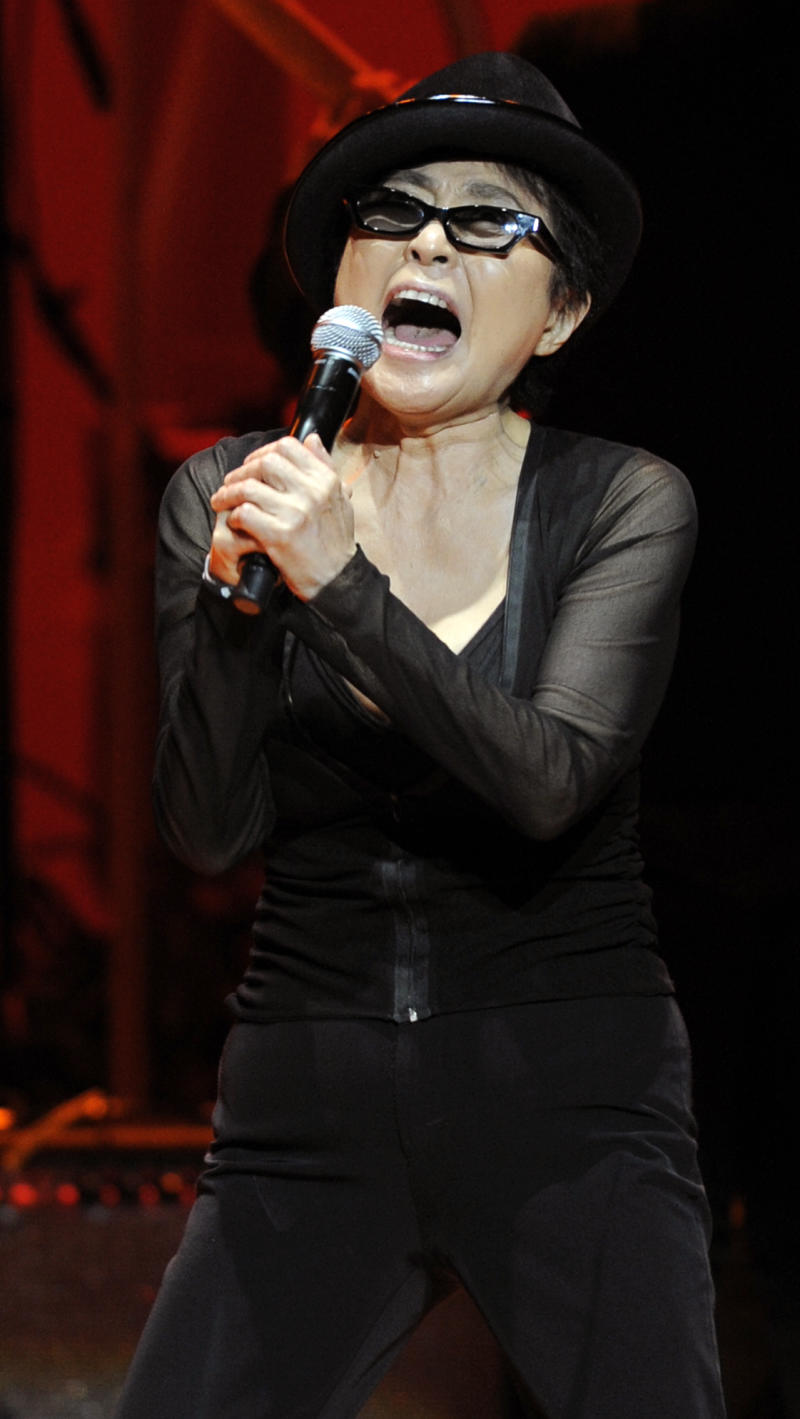 """Yoko Ono performs during the """"Yoko Ono: We Are Plastic Ono Band"""" concert at the Orpheum Theater in Los Angeles, Friday, Oct. 1, 2010. (AP Photo/Chris Pizzello)"""