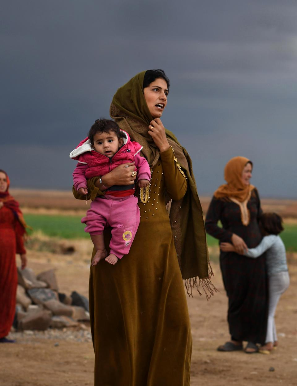 """October 29, 2019, Tel Tamir, Syria: Fida Aziz and her baby Maya fleeing the conflict in Syria as Turkish and Turkish-backed forces move to enforce a """"safe zone"""" in territory along the border previously held by Kurdish militias. (Photo:  ©Carol Guzy/ZUMA Wire)"""