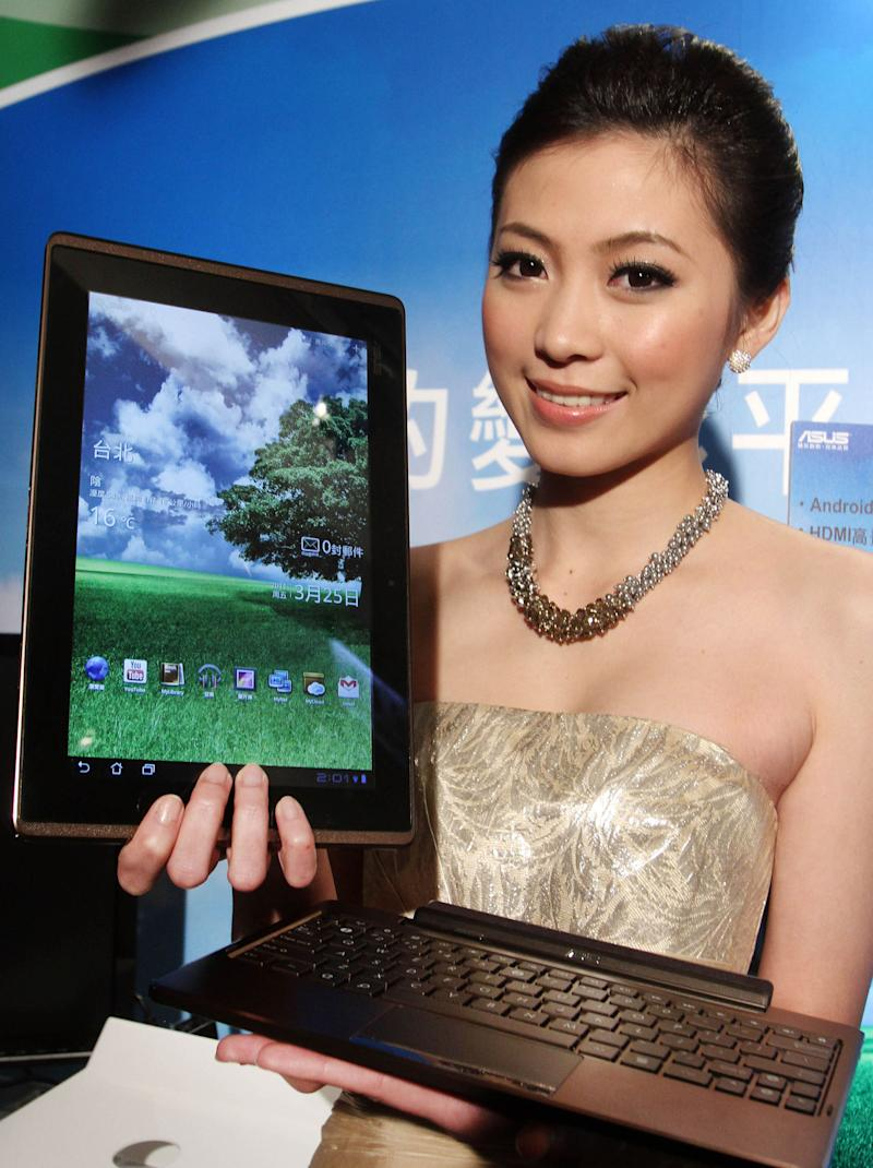 A Taiwanese model displays an Asus Eee Pad Transformer during its new product media event, Friday, March 25, 2011, in Taipei, Taiwan. The Asus Eee Pad Transformer features a 10.1-inch touch screen, tablet with a detachable keyboard dock. It will go on the Taiwanese market at a price of NT$17,999 (US$ 611) for the 16GB model and NT$19,999 (US$ 679) for the 32GB model. (AP Photo/Chiang Ying-ying)