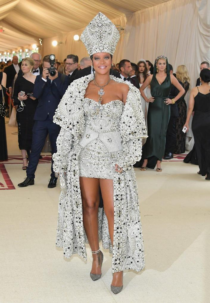 Rihanna wearing a silver look for the heavenly bodies Met Gala in 2018
