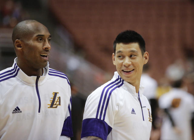 Los Angeles Lakers' Jeremy Lin smiles whilte talking to Kobe Bryant before a preseason NBA basketball game against the Phoenix Suns on Tuesday, Oct. 21, 2014, in Anaheim, Calif. (AP Photo/Jae C. Hong)