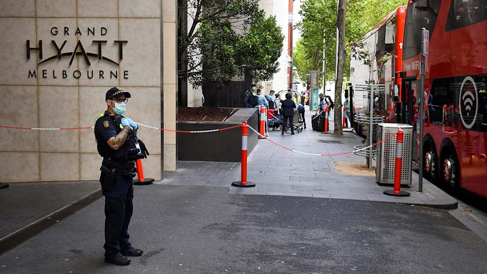 A policeman, pictured here keeping watch as tennis players, coaches and officials arrive at a hotel in Melbourne.