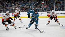 Calgary Flames' Johnny Gaudreau (13), Elias Lindholm (28) and Sean Monahan (23) chase San Jose Sharks' Logan Couture (39) in the second period of an NHL hockey game in San Jose, Calif., Sunday, Nov. 11, 2018. (AP Photo/Josie Lepe)