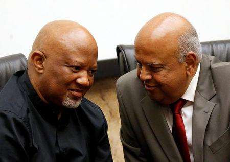 FILE PHOTO: South Africa's outgoing Finance Minister Pravin Gordhan (R) chats with Deputy Minister Mcebisi Jonas during a media briefing at their offices in Pretoria, South Africa, March 31, 2017. REUTERS/Siphiwe Sibeko