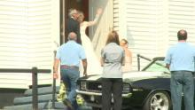 Elisha Cuthbert waved to the crowd outside the church.