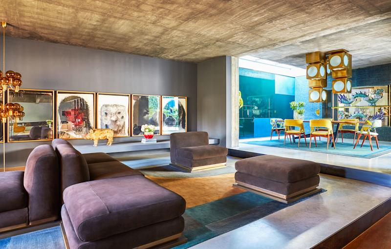 In the lounge area of the living room, De Cotiis designed the custom suede seating on brass bases. Alessandro Verdi charcoal works on paper; custom rug by De Cotiis.