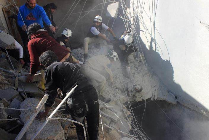 Members of the civil defence pull a boy out from under the rubble following air strikes by suspected Russian planes on the Syrian city of Aleppo (AFP Photo/Thaer Mohammed)
