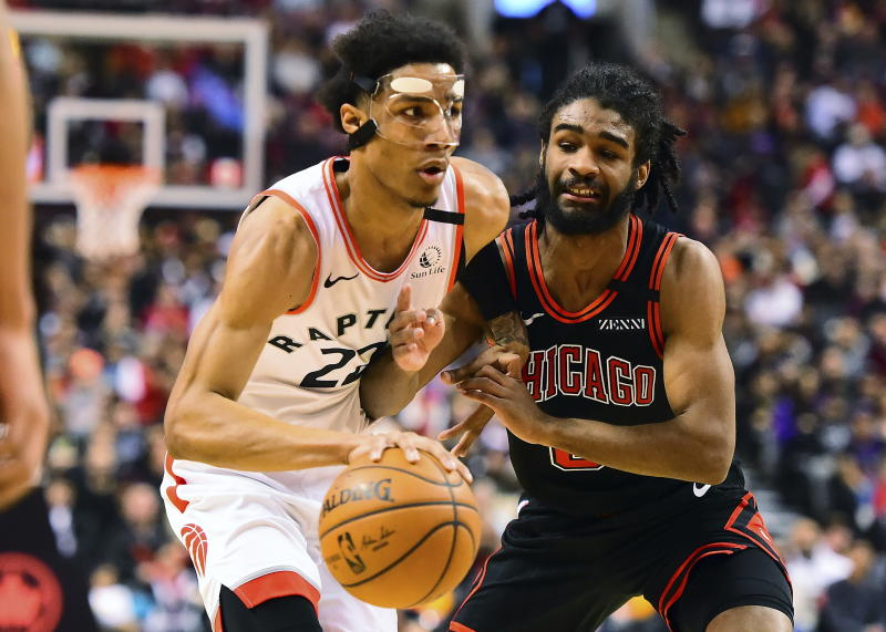 Toronto Raptors forward Patrick McCaw (22) moves the ball past Chicago Bulls guard Coby White (0) during first-half NBA basketball game action in Toronto, Sunday, Feb. 2, 2020. (Frank Gunn/The Canadian Press via AP)