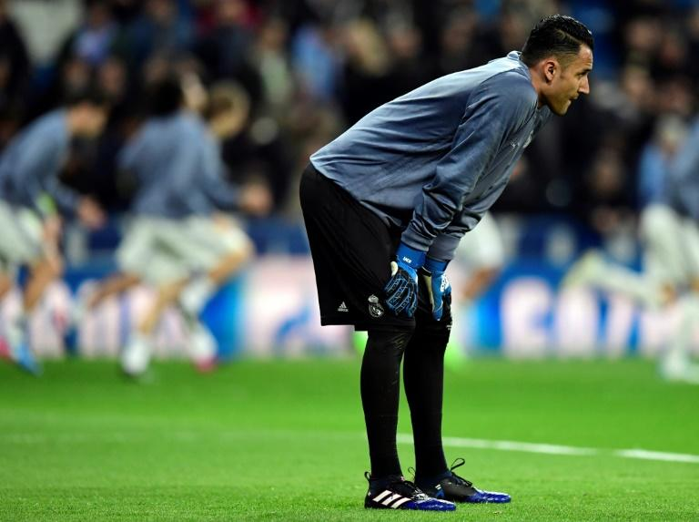 Real Madrid's goalkeeper Keylor Navas warms up ahead of an UEFA Champions League match in Madrid, on February 15, 2017