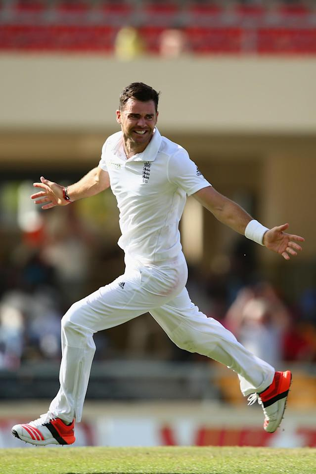 <p>James Anderson of England claims the wicket of Denesh Ramdin to pass Ian Botham's record of 383 in April 2015 </p>