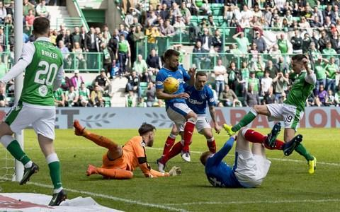 "A ridiculously eventful climax to the Scottish Premiership schedule saw Celtic, Aberdeen, Hibernian and Rangers embroiled in a spectacular resolution of the final league placings. Celtic, of course, were guaranteed a seventh successive title party, which duly proceeded at a packed Parkhead, but only after they had lost at home to Scottish opponents for the first time since Brendan Rodgers became Hoops manager in the summer of 2016. The setback was inflicted by Aberdeen, for whom Andrew Considine's 47th-minute goal ended a lamentable run of 25 consecutive defeats over 14 years of visits to the east end of Glasgow, hence the visitors' celebrations after the final whistle, although these were marred somewhat when Shay Logan was shown a post-match red card for his part in an altercation with Mikael Lustig. Considine's contribution also guaranteed the Dons the runners-up spot for the fourth year in a row and quashed Rangers' hopes of a second-place finish to an otherwise dispiriting season. In fact, within 22 minutes of their visit to Easter Road, Rangers looked on the verge of a humiliation as great as those inflicted by Celtic in the William Hill Scottish Cup semi-final and in the title clincher last month. Hibernian raced to a 3-0 lead, beginning their scoring spree with a Florian Kamberi penalty after Jamie Maclaren had been fouled by David Bates, the Rangers defender who was playing his last game for the club before heading to Hamburg during the close season. Jamie Maclaren scrambles home a 90th minute equaliser Credit: Getty images Scott Allan made it 2-0 when he connected at close range with a prompt from Vykintas Slivka and Maclaren netted Hibs' third with a header from a Lewis Stevenson cross midway through the first half. At that stage of the proceedings there seemed to be a significant chance that Hibs could get to 6-0, the scoreline required to displace the Ibrox side from third place in the table. Instead, Rangers retorted with three goals inside a quarter of an hour. The revival began when James Tavernier beat Ofir Marciano with a right-foot shot from the centre of the Hibs' box and it continued two minutes later when Jordan Rossiter found the mark from almost the same position. Bruno Alves replaced Sean Goss in the Rangers midfield – Goss punching the dugout on his way off – and the Portuguese centre-back's presence paid a dividend five minutes before the break when he equalised with a beautifully controlled free-kick. Astoundingly, 10 minutes into the second half, Rangers went ahead with a Jason Holt shot and increased their lead when Holt supplied Jason Windass for a scoring finish just before the hour mark. The visitors' celebrations were promptly curtailed as Maclaren struck again for his second of the afternoon and, with five minutes remaining, Rangers were reduced to 10 men when Holt was shown a second yellow card for a needless foul on John McGinn. Easter Road was in a ferment as the contest moved into six minutes of stoppage time, midway through which Maclaren turned a pass from Brandon Barker over the line to make it 5-5. Aberdeen secured second place Credit: PA For Rangers, the most significant consequence of the afternoon's results is that Steven Gerrard's first competitive game in charge at Ibrox will be the first leg of the Europa League first qualifying round on July 12. Hibs, meanwhile, will play in Europe if Celtic beat Motherwell in the William Hill Scottish Cup final on Saturday, but if the Steelmen upset the odds at Hampden Park, Neil Lennon's men will not qualify for the Europa League. Lennon, who had questioned his own future at Hibs after the derby defeat by Hearts at Tynecastle on Wednesday – and who had missed training and his media briefing on Friday – drew back from his threat to leave Easter Road. ""I've had a bad virus the last two or three weeks and I just couldn't get out of bed on Friday,"" he said. ""I know the conspiracy theories were flying around but I wasn't well and thankfully I'm coming out of the remnants now. ""However, what I have done is opened up a lot of unnecessary speculation and analysis of my relationship with the board and there's just nothing there. The board have backed me every step of the way. ""I do not make demands of the board, I do not throw the toys out of the pram – in fact I'm the exact opposite and have been throughout my managerial career. They gave me extra funds in January if we wanted to sign an extra player and we decided not to go with that. ""All the speculation about me making demands or being unhappy with the club couldn't be further from the truth."" Indeed, Lennon finished his season by being sent off for running to the pitch to gesture towards the Rangers support when Hibs made it 5-5, although his grinning departure did not suggest contrition. ""I was getting a bit of stick from the Rangers support so I gave them some back,"" he said. ""It was bonkers. We were 3-0 up but – and I can't believe I'm saying this – we needed the fourth."""