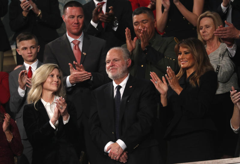 Rush Limbaugh reacts as first Lady Melania Trump, and his wife Kathryn, applaud, as President Donald Trump delivers his State of the Union address to a joint session of Congress on Capitol Hill in Washington, Tuesday, Feb. 4, 2020. (Leah Millis/Pool via AP)