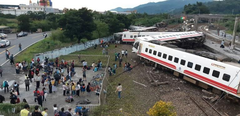 All eight carriages on the Puyuma Express train in Taiwan were derailed and five flipped onto their side in the accident