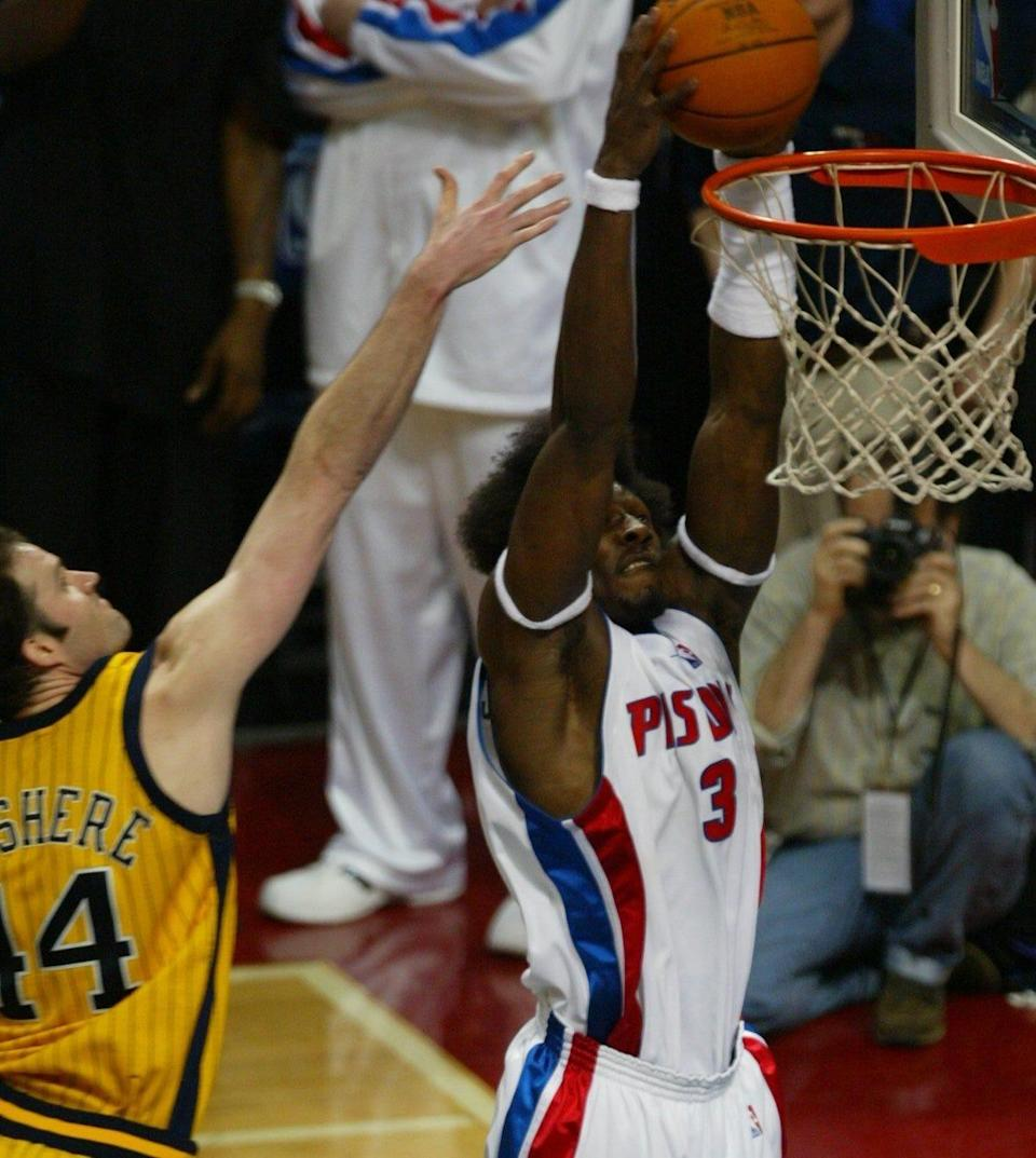 Ben Wallace dunks with 11 seconds remaining to seal the Pistons' 69-65 win over the Indiana Pacers in Game 6 of the Eastern Conference finals Tuesday, June 1, 2004 at the Palace of Auburn Hills.