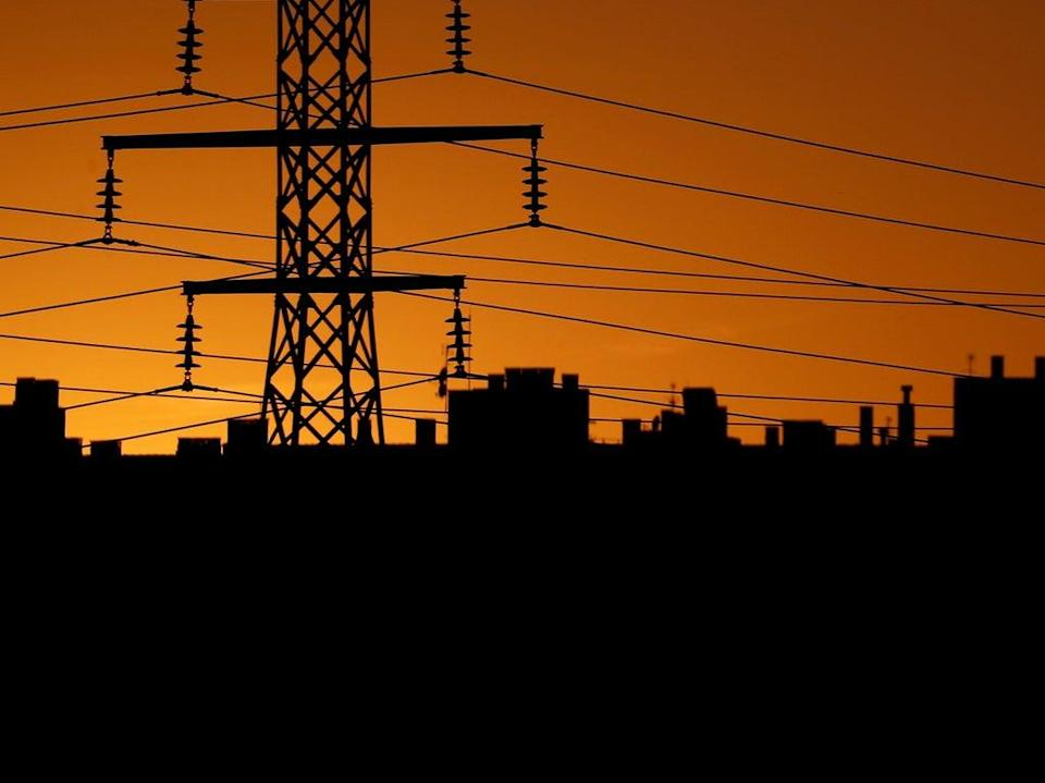 UK households and businesses will pay almost three times as much for electricity next year compared to government forecasts (Reuters)