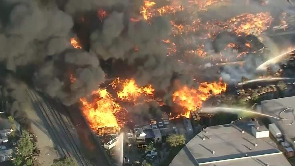 A massive fire has erupted at a recyclying plant in Ontario, California. Rough Cut (no reporter narration).