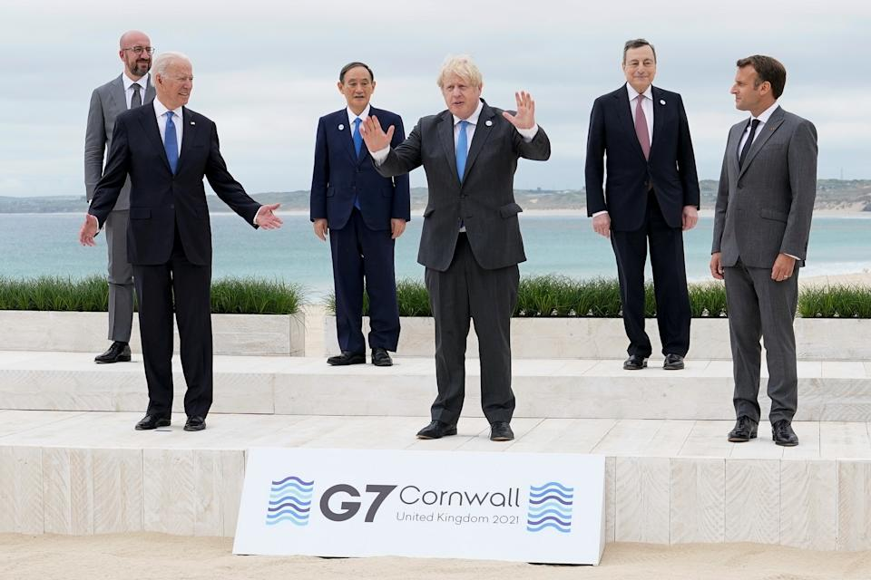 U.S. President Joe Biden and British Prime Minister Boris Johnson gesture as they pose for a family photo with G-7 leaders; European Council President Charles Michel, Japan's Prime Minister Yoshihide Suga, Italy's Prime Minister Mario Draghi and French President Emmanuel Macron at the G-7 summit, in Carbis Bay, Cornwall, Britain June 11, 2021. Patrick Semansky/Pool via REUTERS     TPX IMAGES OF THE DAY