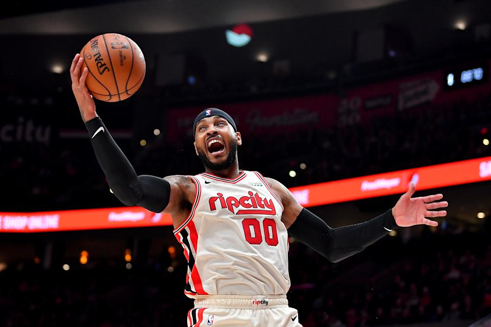 PORTLAND, OREGON - NOVEMBER 29: Carmelo Anthony #00 of the Portland Trail Blazers grabs a rebound during the second half of the game against the Chicago Bulls at the Moda Center on November 29, 2019 in Portland, Oregon.  The Trail Blazers won 107-103.  NOTE TO USER: User expressly acknowledges and agrees that, by downloading and or using this photograph, User is consenting to the terms and conditions of the Getty Images License Agreement.  (Photo by Alika Jenner/Getty Images)