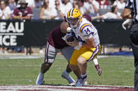 LSU quarterback Max Johnson (14) is sacked by Mississippi State defensive end Aaron Odom during the first half of an NCAA college football game, Saturday, Sept. 25, 2021, in Starkville, Miss. (AP Photo/Rogelio V. Solis)