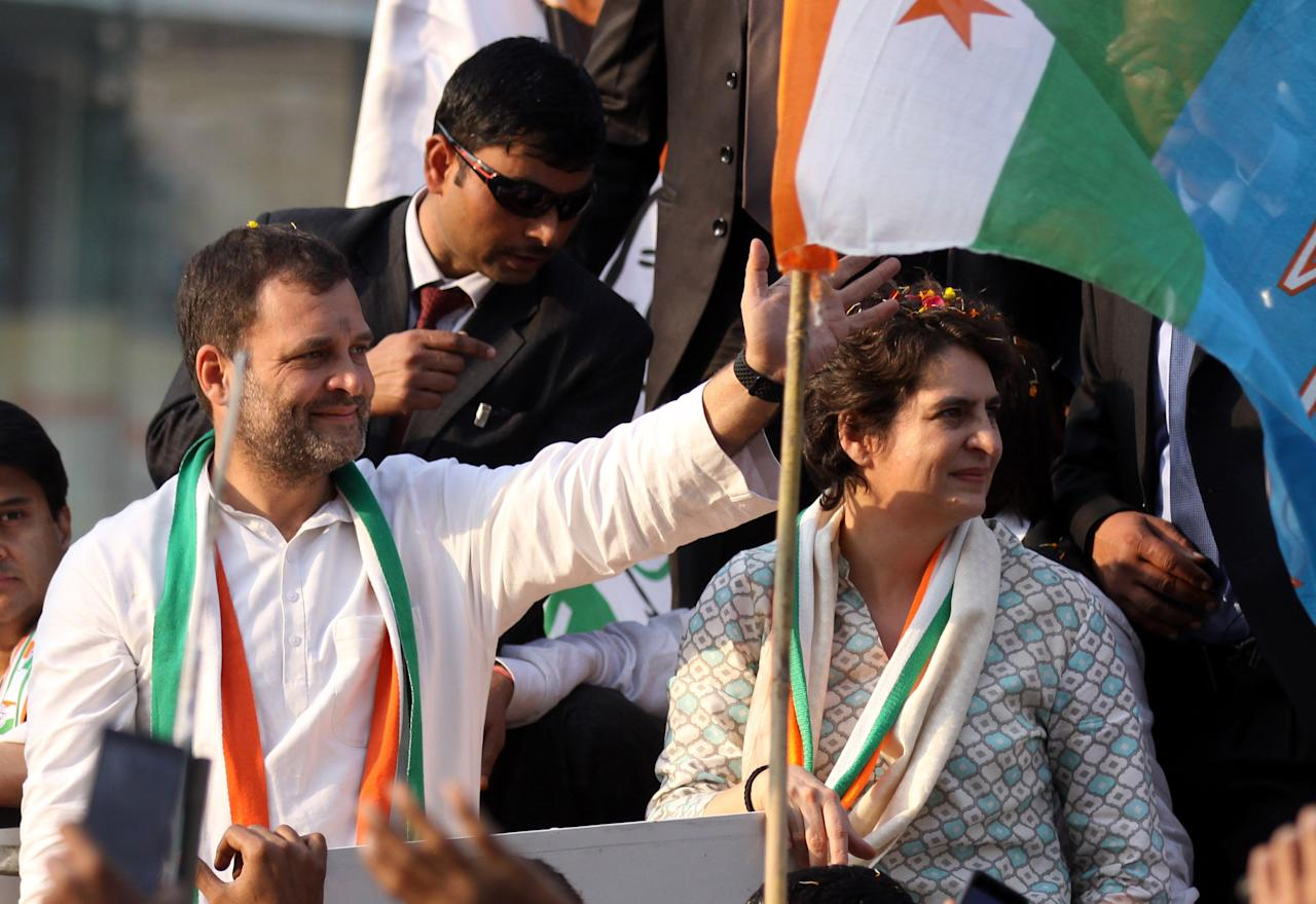 <p>Indian Congress Party leader Rahul Gandhi (L) talks with his sister Priyanka Gandhi Vadra (R) at her first public rally in Lucknow, the capital of the election bellwether Uttar Pradesh state, on February 11, 2019. – India's charismatic opposition leader Priyanka Gandhi Vadra held her first public rally February 11, setting the stage for a keen contest with Prime Minister Narendra Modi in an upcoming general election. (Photo by STR / AFP) (Photo credit should read STR/AFP/Getty Images) </p>