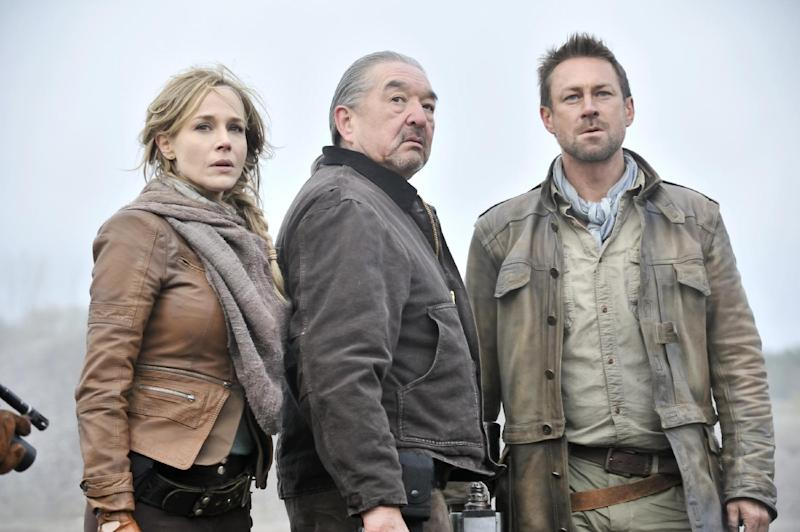 "This publicity image released by Syfy shows Julie Benz as Amanda Rosewater, left, Graham Greene as Rafe McCawley, and Grant Bowler as Jeb Nolan, right, in a scene from the series, ""Defiance,"" premiering Monday, April 15, 2013 at 9 p.m. EST on Syfy. (AP Photo/Syfy, Ben Mark Holzberg)"