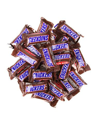"""<div class=""""caption-credit""""> Photo by: WomansDay.com</div><div class=""""caption-title"""">Snickers</div>This offender is filled with everything healthy eats shouldn't have-nougat, caramel and, of course, chocolate. """"Chocolate is loaded with fat and calories,"""" says Christen Cupples Cooper, RD, owner of Cooper Nutrition in Pleasantville, NY. Plus, """"caramel is a serious source of tooth decay,"""" says Cindy Flanagan, DDS, spokesperson for the General Academy of Dentistry. """"It gets stuck in the crevices between teeth, which makes it impossible for saliva to wash it away."""" The result? Cavities. If your child must indulge her sweet tooth, """"go for chocolates with a non-dense, airy filling, such as 3 Musketeers,"""" recommends Jacqueline Santora Zimmerman, RD, a nutritionist in New York City. <br> <br> <b>You Might Also Like: <br></b> <a rel=""""nofollow"""" href=""""http://www.womansday.com/health-fitness/conditions-diseases/bad-habits-that-are-good-for-you?link=badhabits&dom=yah_life&src=syn&con=blog_wd&mag=wdy"""" target=""""""""><b>9 Bad Habits That Are Good For You</b></a> <b><br></b><a rel=""""nofollow"""" href=""""http://www.womansday.com/health-fitness/diet-weight-loss/20-ways-to-burn-more-fat-1654?link=burnfat&dom=yah_life&src=syn&con=blog_wd&mag=wdy"""" target=""""""""><b>20 Easy Ways to Burn More Fat</b></a> <br>"""