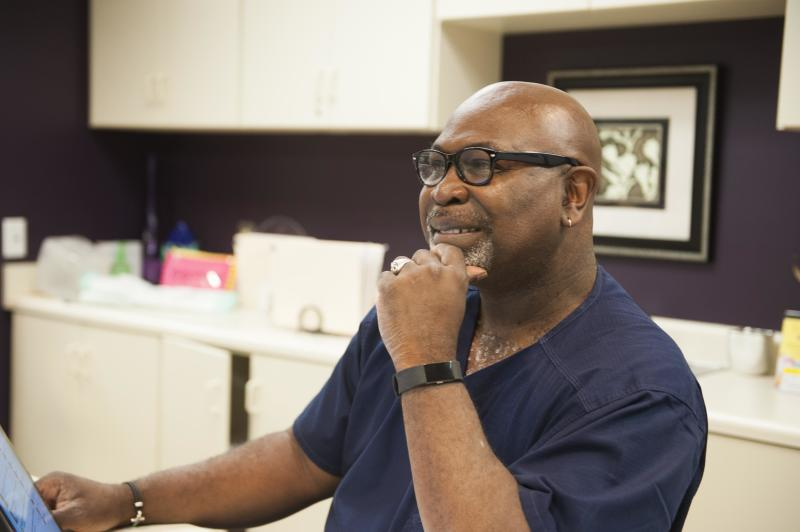 Dr. Willie Parker, one of Alabama's few remaining abortion providers, works in the Huntsville clinic. (Chloe Angyal/HuffPost)