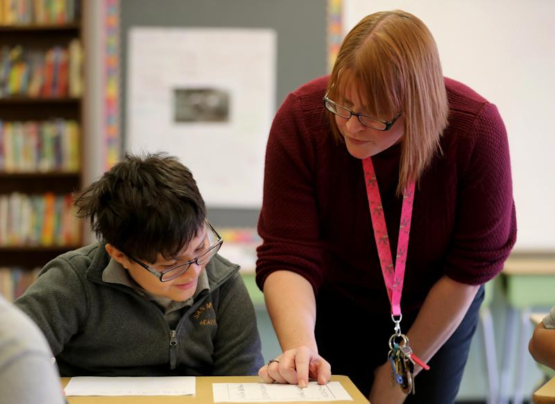 Kerry DiMeo, a fifth-grade teacher at the San Miguel Academy of Newburgh, works with Sebastian Sanchez during a lesson on the ancient writing system called Cuneiform Dec. 5, 2018. The San Miguel Academy, a fifth through eighth grade school, was created 12 years ago to serve low-income and at-risk youth in Newburgh. The school came to be with the help of a group of Chappaqua residents who assisted Father Mark Connell, who at the time was an assistant Pastor at Church of St Mary's in Chappaqua, in it's creation.