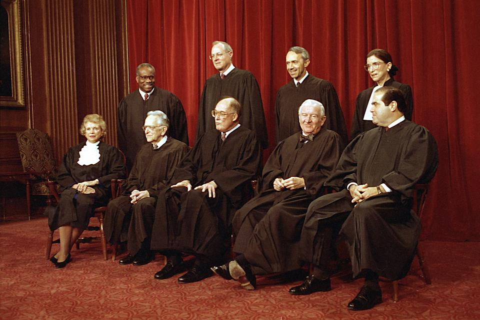 Members of the U.S. Supreme Court pose for their group portrait in Washington. Standing, from left: Associate Justices Clarence Thomas, Anthony M. Kennedy, David Souter, and Ruth Bader Ginsburg. Seated, from left are: Sandra Day O'Connor, Harry Blackmun, Chief Justice William Rehnquist, John Paul Stevens and Antonin Scalia. (Photo: Marcy Nighswander/AP)